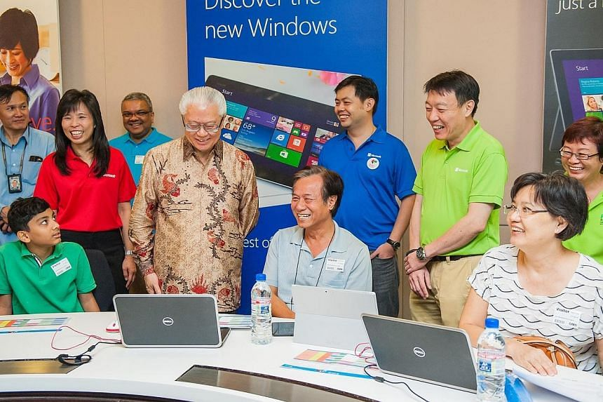 President Tony Tan and Microsoft Singapore managing director Jessica Tan visiting the IT Workshop at the We Tech Care Open House. -- PHOTO: MICROSOFT SINGAPORE