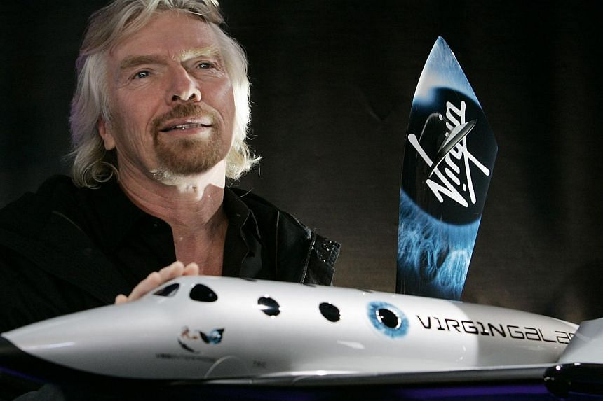 A Jan 23, 2008 file photo shows Sir Richard Branson, founder of Virgin Galactic, with a model of SpaceShipTwo in New York. Virgin Galactic's first commercial spacecraft crashed Friday during a test flight over California, scattering debris ove