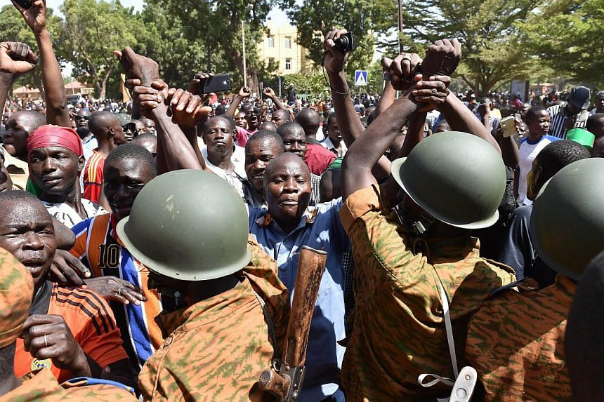 """A crowd gathers on Oct 31, 2014 in front of army headquarters in Ouagadougou, demanding that the army take over following the resignation of the president.A group of Burkina Faso army officers claimed on Friday to have """"taken the destiny of the"""