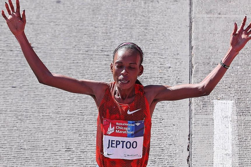 Rita Jeptoo of Kenya celebrates after winning of the Chicago Marathon on Oct 12, 2014. Jeptoo, winner of the Boston and Chicago Marathons for the last two years, has failed an out-of-competition doping test, Athletics Kenya said on Friday. -- PHOTO:&