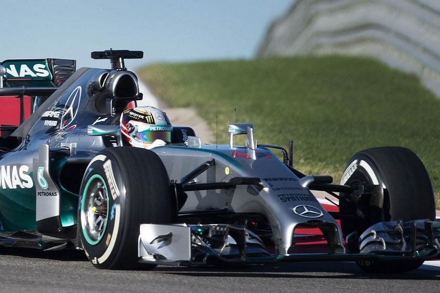 British driver Lewis Hamilton of Mercedes AMG Petronas takes a turn during the first practice session for the United States Formula One Grand Prix at the Circuit of the Americas track in Austin, Texas, Oct 31, 2014. -- PHOTO: AFP