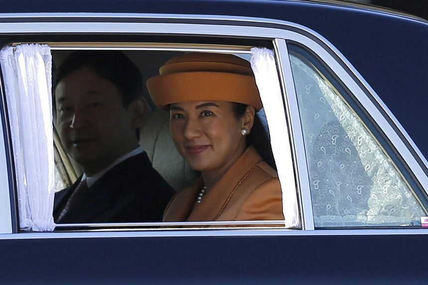 Japan's Crown Princess Masako (right) and Crown Prince Naruhito leave a welcoming ceremony for King Willem Alexander and Queen Maxima of the Netherlands at the Imperial Palace in Tokyo on Oct 29, 2014. King Willem Alexander and Queen Maxima are in Ja