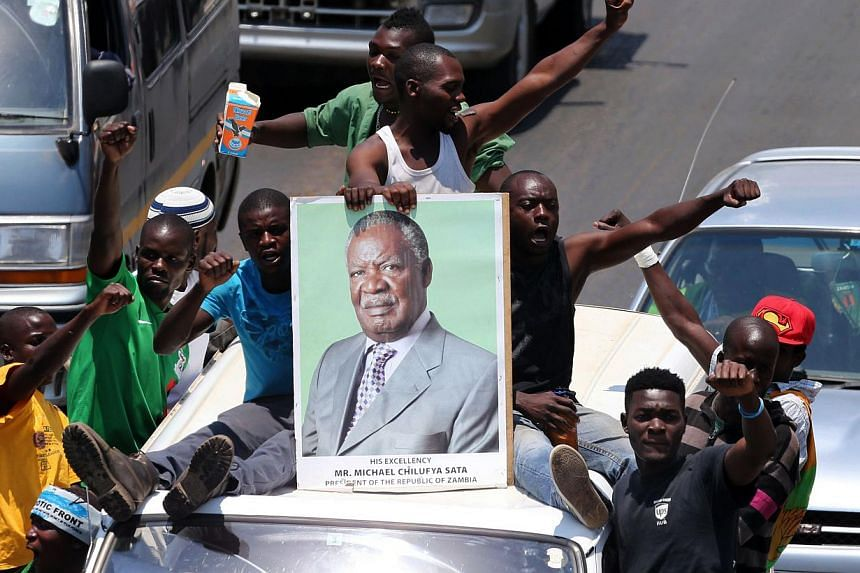 Patriotic Front cadres escort President Michael Sata's body to Mulungushi International Conference Centre on Nov 1, 2014 in Lusaka.Hundreds of people lined Lusaka's Great East road on Saturday as the body of Zambian president Michael Sata, who