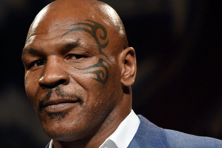Former heavyweight champion Mike Tyson - seen here (above) in Las Vegas on Aug 9, 2014 -  was sexually abused when he was seven years old by a stranger on the street, he told US radio. -- PHOTO: AFP