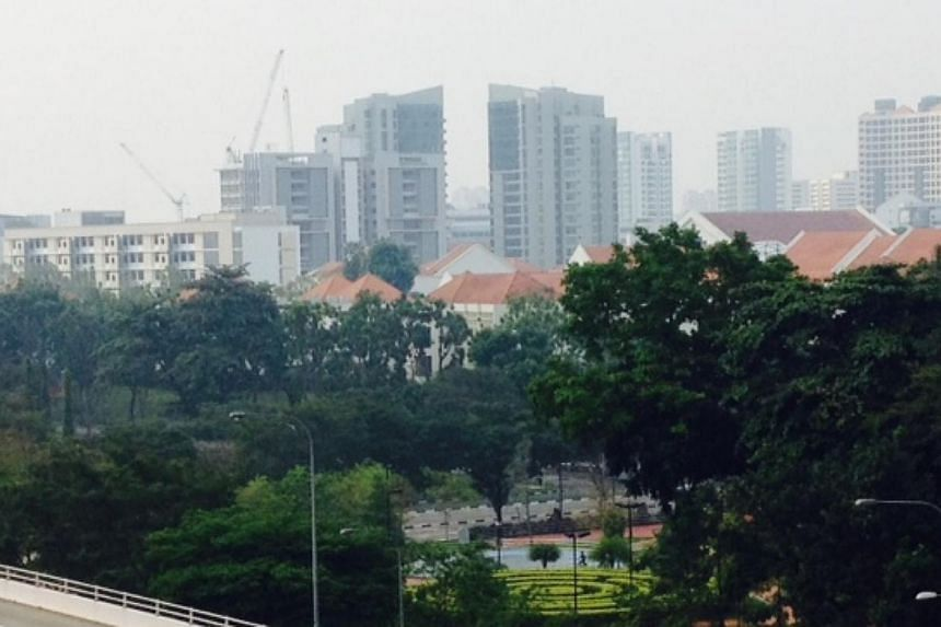 Haze covering Bishan estate at 3.25pm on Sunday.The three-hour Pollutant Standards Index (PSI) inched upwards into the unhealthy range on Sunday afternoon, hitting 104 at 3pm. -- ST PHOTO: AZIZ HUSSIN