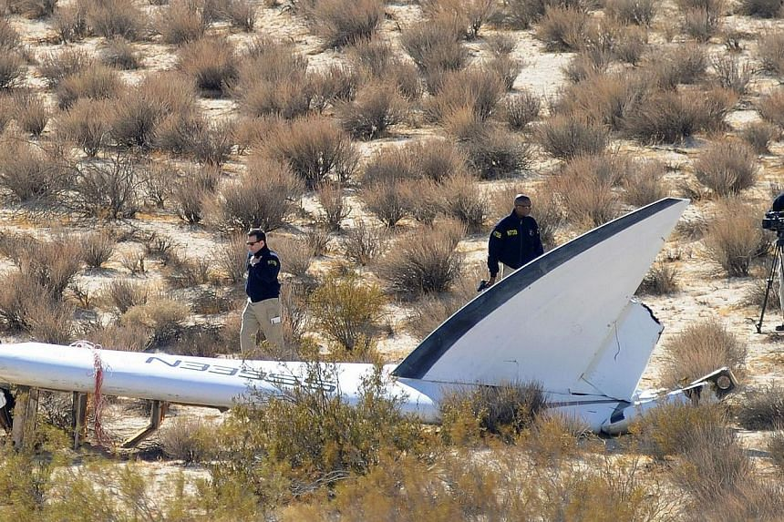 A National Transportation Safety Board (NTSB) team surveys a tail section from the crashed Virgin Galactic SpaceShipTwo near Cantil, California, on Nov 01, 2014. Authorities who carried out their first full day of investigation into a US spacecr