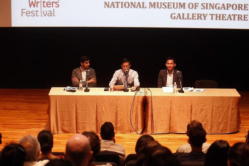 """Singapore Writers Festival panel """"How To Run A Country: Can Singapore Provide A Model?"""" featuring Donald Low (right) and Parag Khanna (left) and moderated by SPH's Robin Chan. -- ST PHOTO:CHEW SENG KIM"""