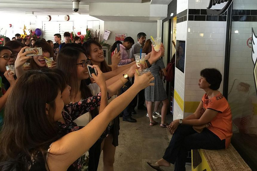 Fans of Honey Creme (above) taking selfies with and photos of their ice cream. -- PHOTO: EUNICE QUEK