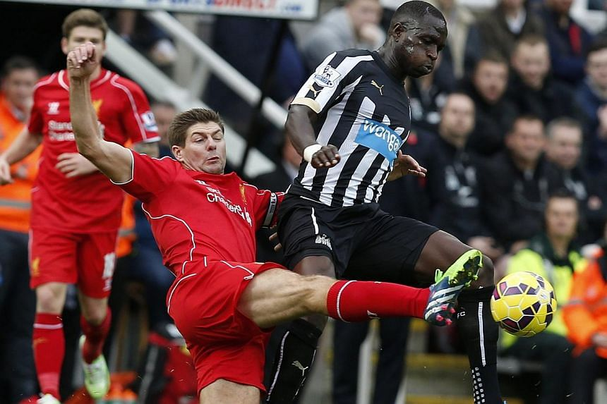 Liverpool's Steven Gerrard (left) challengesNewcastle United's Moussa Sissoko during their English Premier League soccer match in Newcastle, northern England Nov 1, 2014. Liverpool manager Brendan Rodgers said on Saturday he wants long-serving