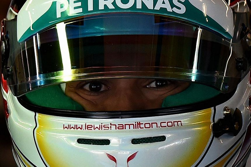 Mercedes AMG Petronas driver Lewis Hamilton of Britain arrives in the pits before posting the fastest time during the final practice session of the United States Formula One Grand Prix at the Circuit of The Americas in Austin, Texas on Nov 1, 2014. -
