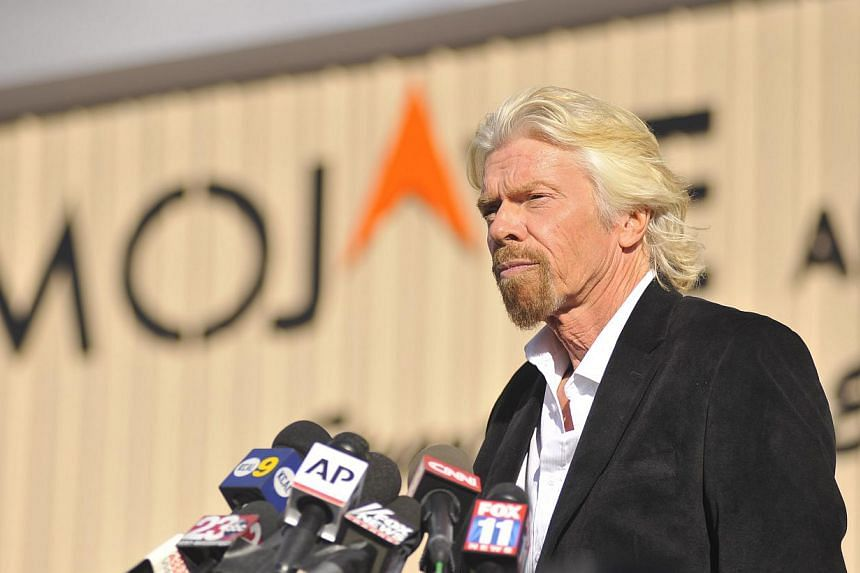 Virgin founder Richard Branson speaks at a press conference at the Mojave Air and Space Port in Mohave, California on Nov 1, 2014. Branson insisted on Saturday that his dream of commercial space travel remained alive but warned his company would not