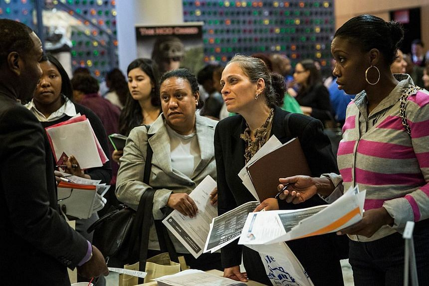 A jobs fair at the Bronx Public Library on Sept 17, 2014, in the Bronx Borough of New York City. -- PHOTO: AFP