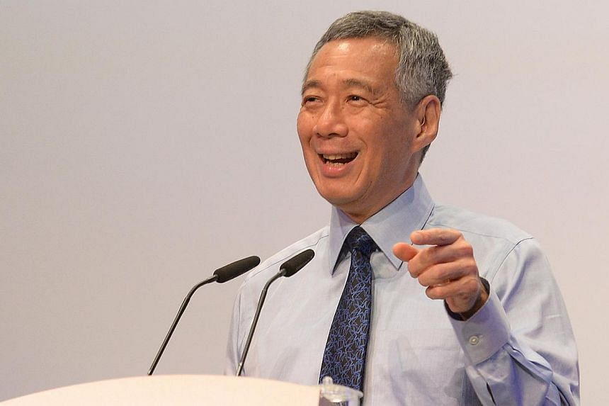 PM Lee Hsien Loong speaking at the launch of the inaugural National Productivity Month on Oct 7, 2014. He announced on Monday that the Government has set up a $30 million fund to help Singaporeans master skills for the future. -- ST PHOTO:JAMIE