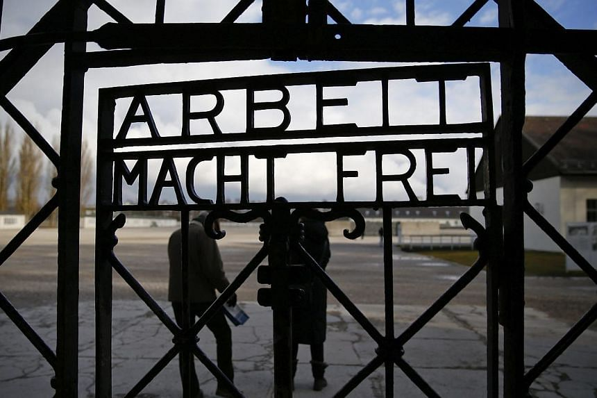 """The main gate of the former Dachau concentration camp with the sign """"Arbeit macht frei"""" (work sets you free) is seen in Dachau, near Munich, in this Jan 25, 2014 file picture. -- PHOTO: REUTERS"""