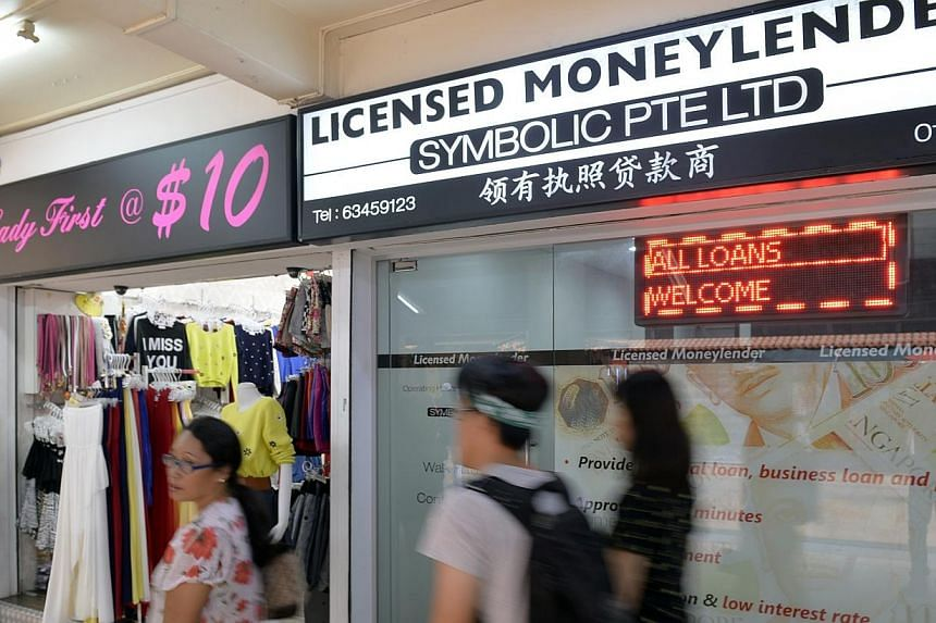 An advisory committee on moneylending has suggested implementing caps on how much a person can borrow from licensed moneylenders, as well as on the interest rates applied by the moneylenders. -- PHOTO: ST FILE
