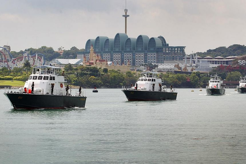 Coast Guard ships sailing just off the shore of Sentosa Island.A new law to combat  human trafficking, which Members of Parliament called historic, was passed on Monday but not before a 2½ hour debate on whether it went