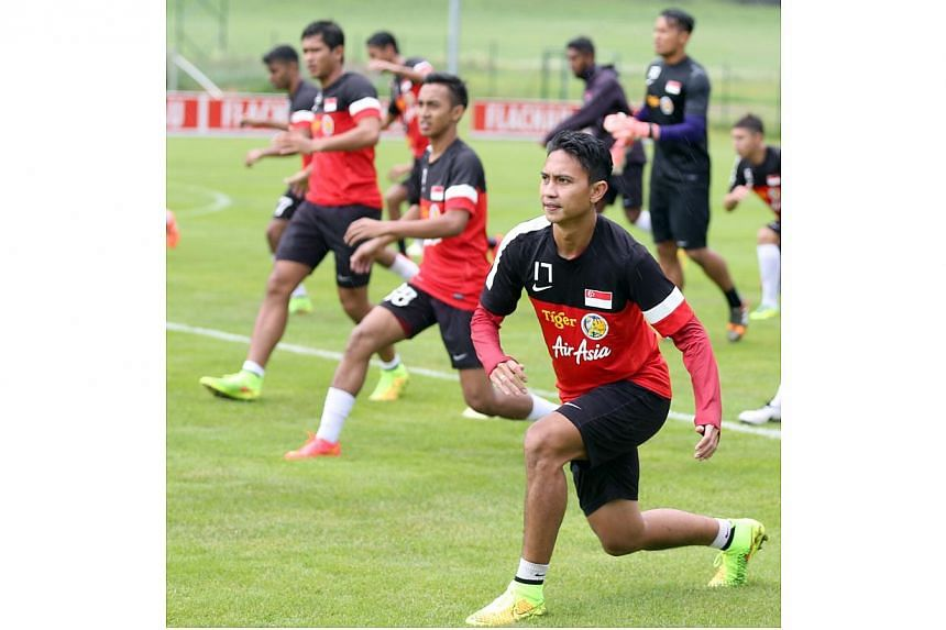 National football team captain Shahril Ishak (right) and winger Faris Ramli (second from right) at their training camp in Almdorf Flachau in Salzburg, Austria. -- PHOTO: FAS
