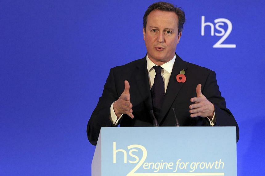 Britain's Prime Minister David Cameron speaks on high speed rail link HS2, at the launch of the HS2 report, in Leeds Civic Hall, northern England on Oct 27, 2014. -- PHOTO: REUTERS