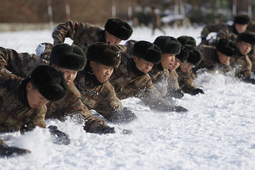 """China's People's Liberation Armysoldiers training in the snow at their camp in Heihe, north-east China's Heilongjiang province on Oct 29, 2014.Anyone calling for the PLA to be loyal to the state rather than the Communist party has a """"very"""
