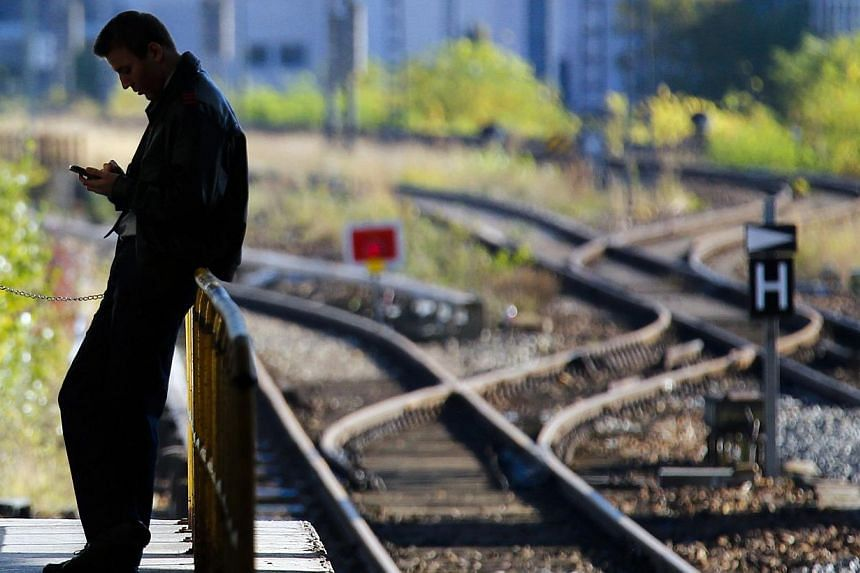 A man stands on a platform at Ostbahnhof Station in Berlin on Oct 19, 2014. -- PHOTO: REUTERS