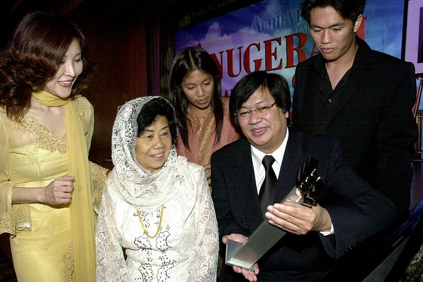 HIGHLIGHTS OF HIS LIFE: Iskandar Mirza Ismail with his Berita Harian Achiever of the Year award and (above, from left) his wife Ernawaty Sorianto, mother Nona Asiah, and children Valerie and Emil in 2003 and taking part in the Chingay Parade in 2004.
