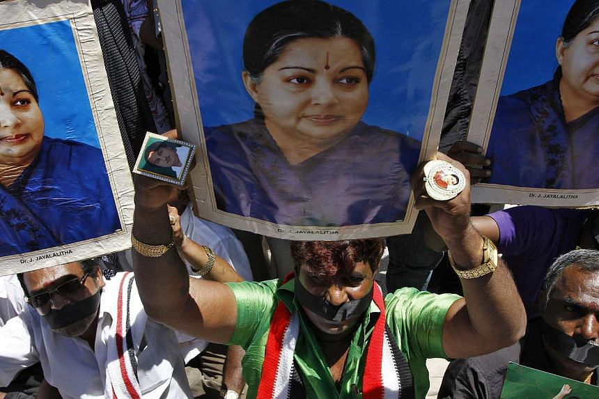 Supporters of convicted political leader Jayalalithaa Jayaram protesting against the court verdict finding her guilty of corruption on Sept 27.