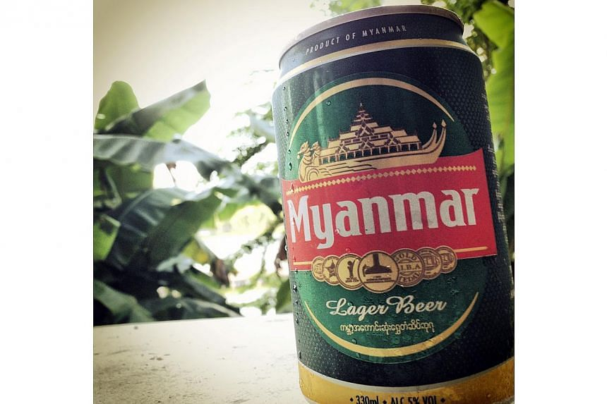The Myanmar military company behind a sprawling business empire has tried to reassure foreign investors after it won a legal tussle to buy out its Singaporean brewery partner Fraser & Neave. -- PHOTO: ST FILE