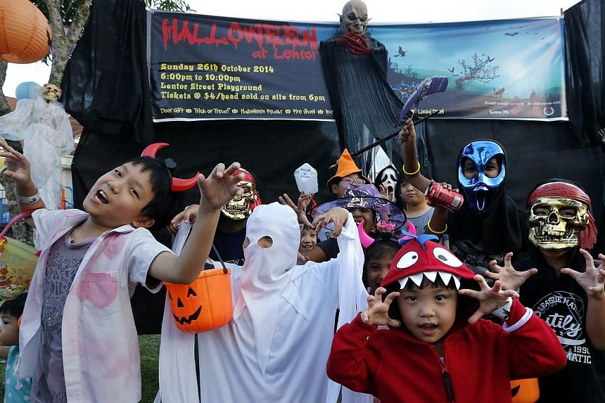 Children at the annual Halloween at Lentor celebration, dressed in their costumes and making scary expressions. -- ST PHOTO: CHEW SENG KIM