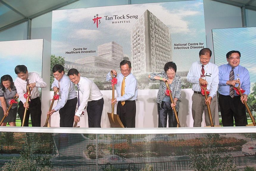 Minister of State for Health Lam Pin Min and Health Minister Gan Kim Yong (fourth and fifth from left) at the groundbreaking ceremony of Tan Tock Seng Hospital's new National Centre for Infectious Diseases and Centre for Healthcare Innovation on Nov