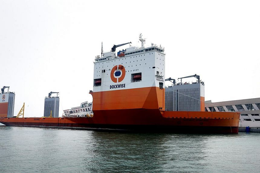 The Dockwise Vanguard - the world's largest semisubmersible heavy transport vehicle - was docked at the Marina Bay Cruise Terminal for two hours on Sunday afternoon. -- ST PHOTO:CHEW SENG KIM