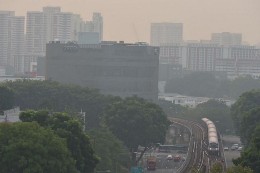 An MRT train approaching Queenstown station at 7am on the morning of Nov 3, 2014. -- ST PHOTO: CAROLINE CHIA
