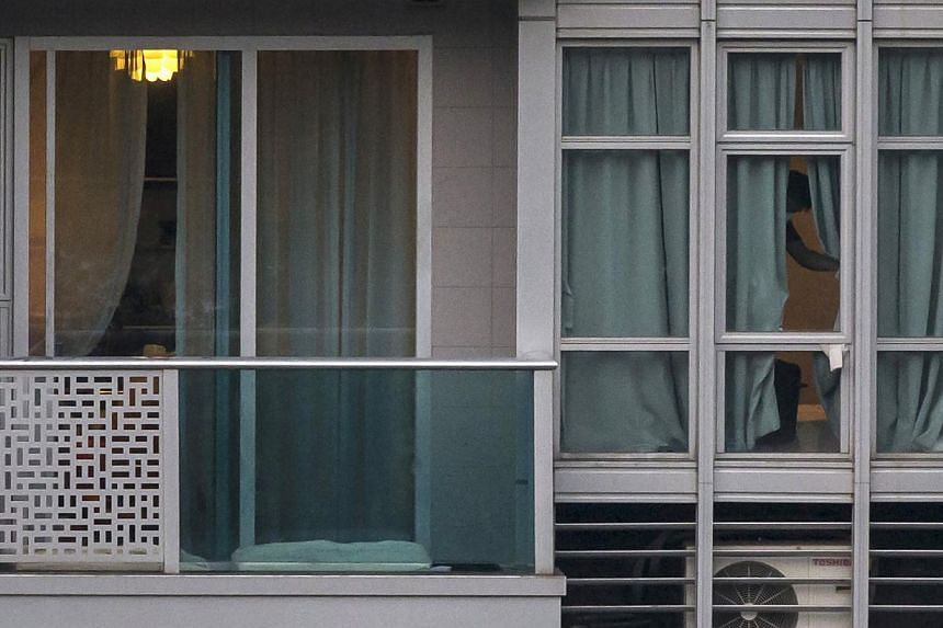 A policeman checks the crime scene in which the bodies of two women were found in a flat at Hong Kong's Wanchai district on Nov 2, 2014. -- PHOTO: REUTERS