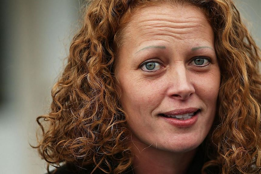 Kaci Hickox gives a statement to the media in front of her home in Fort Kent, Maineon Oct 31, 2014. -- PHOTO: AFP