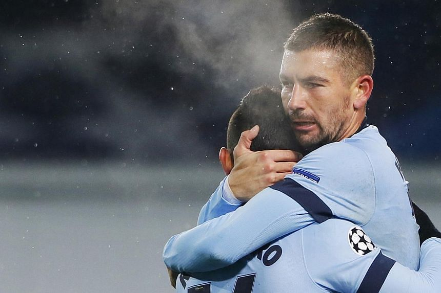 Manchester City's Sergio Aguero (left) is congratulated by teammate Aleksandar Kolarov after scoring a goal during their Champions League Group E soccer match against CSKA Moscow at the Arena Khimki outside Moscow, on Oct 21, 2014.Manchester Ci