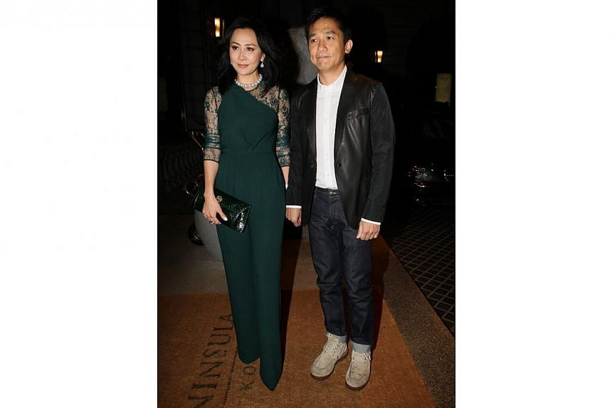 Carina Lau and her husband Tony Leung arrive at the party at The Peninsula Hong Kong on Monday. -- PHOTO: APPLE DAILY
