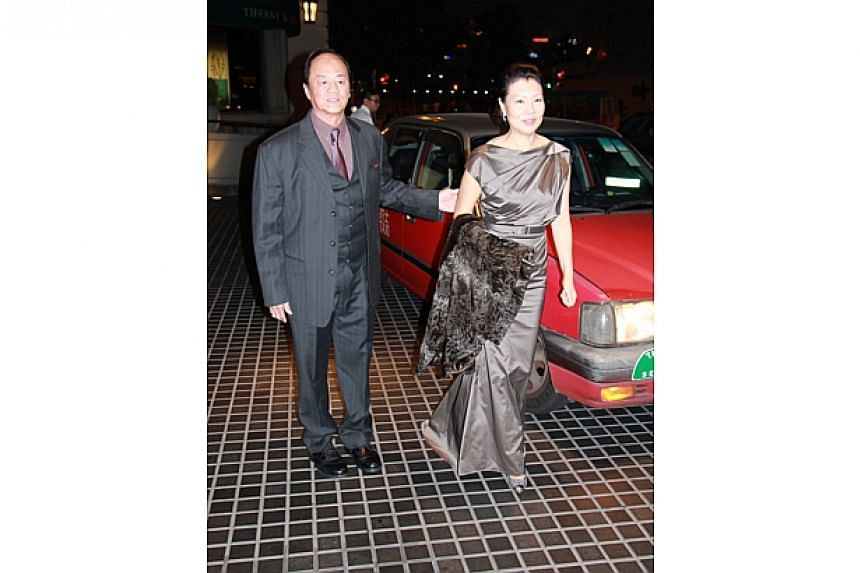 Ti Lung and his wife Tao Ming-min arrive at the party. -- PHOTO: APPLE DAILY