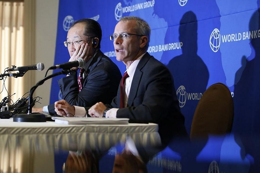 World Bank Group president Jim Yong Kim (left) listens to a reporter's question during a news conference in Seoul on Nov 4, 2014. Asian countries are not contributing enough to the global effort to fight Ebola, despite having a wealth of trained