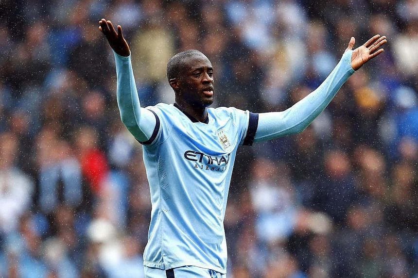 British police on Tuesday announced an investigation into complaints that Manchester City midfielder Yaya Toure was racially abused on Twitter. -- PHOTO: REUTERS