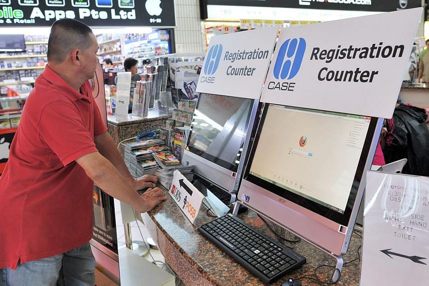 A man standing at the Consumers Association of Singapore (CASE) complaints kiosk for shoppers at Sim Lim Square. -- PHOTO: ST FILE