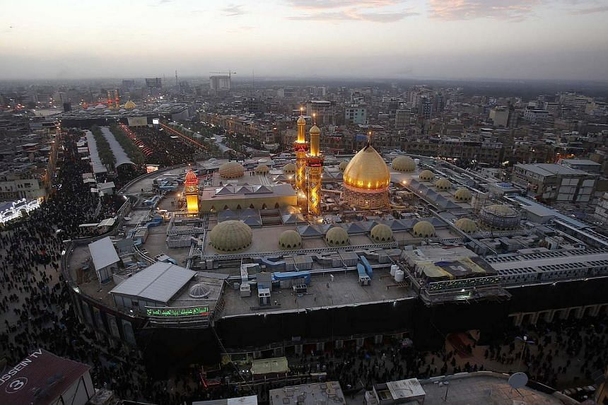 The shrines of Shiite Muslim Imam Hussein (front) and Imam Abbas (background) in the central city of Karbala 80 km (50 miles) southwest of Baghdad. -- PHOTO: AFP