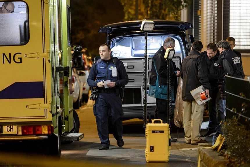 Police and forensic are pictured after a shooting at Wildensteinerstrasse in Basel, northern Switzerland,on Nov 3, 2014. -- PHOTO: AFP
