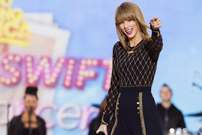 """Singer Taylor Swift performs on ABC's """"Good Morning America"""" to promote her new album """"1989"""" in New York on Oct 30, 2014. -- PHOTO: REUTERS"""