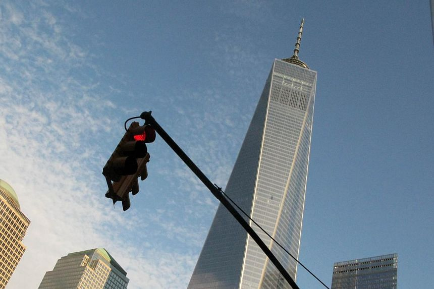 One World Trade Center stands tall above other nearby buildings in New York on Nov 3, 2014. -- PHOTO: AFP