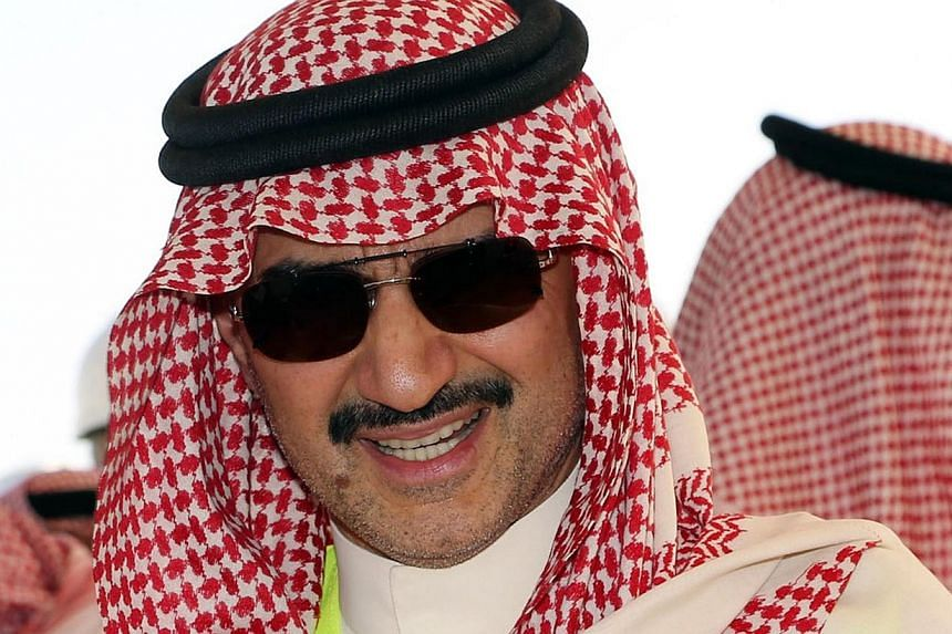 Saudi billionaire owner of Kingdom Holding Company, Prince Alwaleed Bin Talal, speaks to the media during a press conference at the location of the Kingdom Tower and the Kingdom City in Obhor, 30km north of Jeddah City, on Nov 4, 2014. The fall of cr