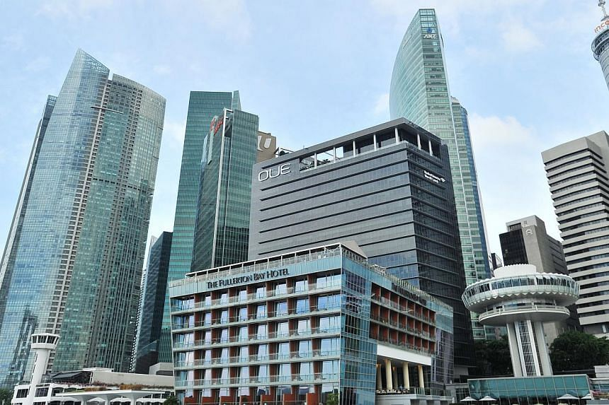 Skyline in the central business district (CBD) consisting of The Fullerton Bay Hotel and NTUC Income building, among other skyscrapers. -- ST PHOTO: LIM YAOHUI