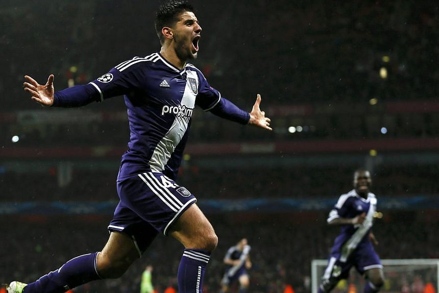 Anderlecht's Aleksandar Mitrovic celebrates after scoring his team's third goal against Arsenal during their Champions League match at the Emirates stadium in London on Nov 4, 2014. -- PHOTO: REUTERS