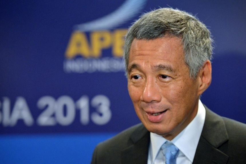 Singapore's Prime Minister Lee Hsien Loong speaking to reporters on the sidelines of the Asia-Pacific Economic Cooperation (APEC) Summit 2013 held at Sofitel Hotel in Nusa Dua in Bali, Indonesia on 8 Oct 2013.The APEC grouping has lived up to e