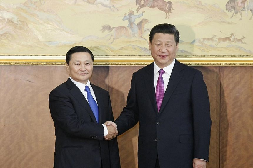 China's President Xi Jinping (right) shakes hands with Mongolia's Prime Minister Norov Altankhuyag at the parliament building during Xi's visit in Ulan Bator, Aug 22, 2014.Mongolia's parliament voted on Wednesday to remove Prime Minister Norov