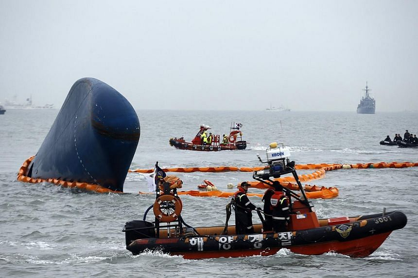 Rescue boats sail around the South Korean passenger ship Sewol which sank, during their rescue operation in the sea off Jindo, April 17, 2014.The son of the South Korean tycoon blamed for the Sewol disaster was sentenced to three years in priso
