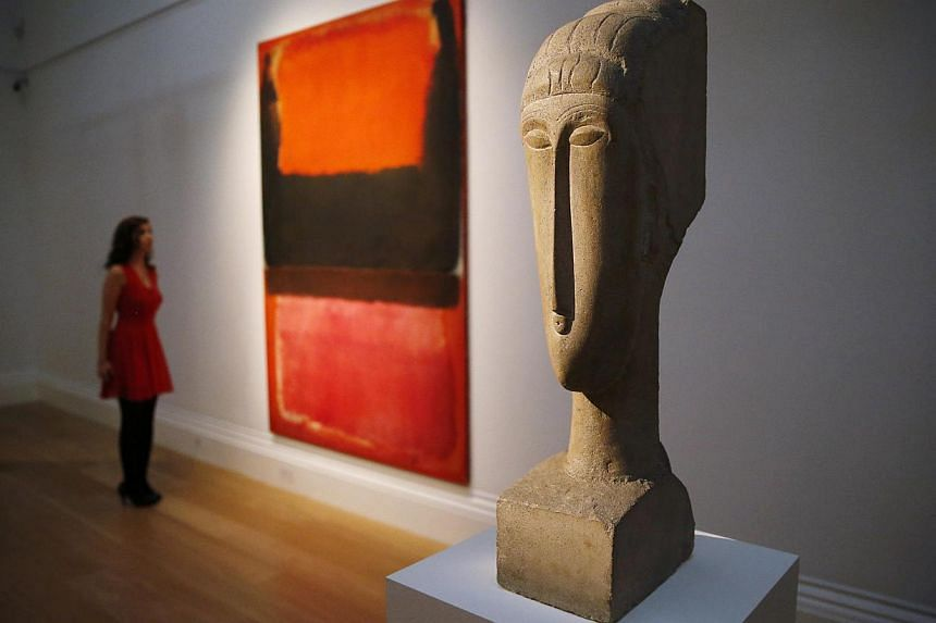 Stone sculpture 'Tete' by artist Amedeo Modigliani was sold for US$70.7 million. -- PHOTO: REUTERS
